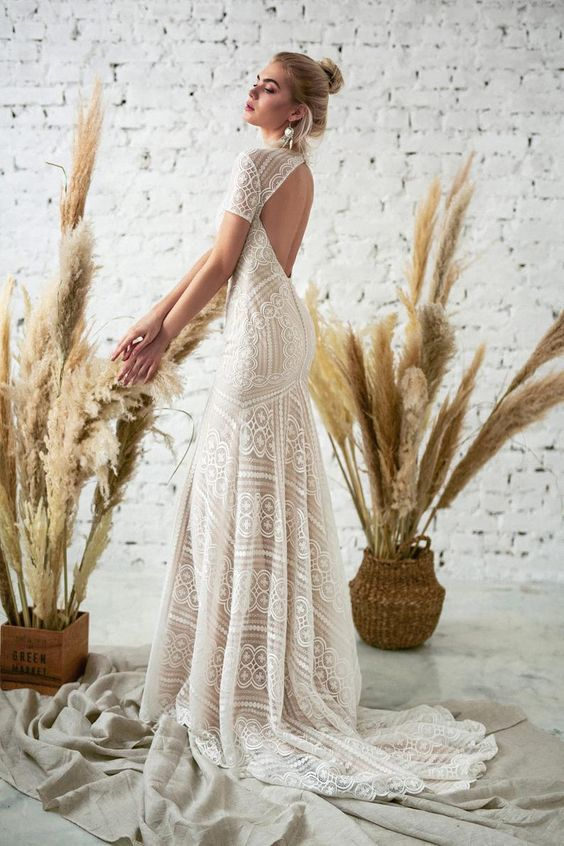 a boho lace mermaid wedding dress with a keyhole back, short sleeves and a short train is a fantastic solution for a modern boho bride