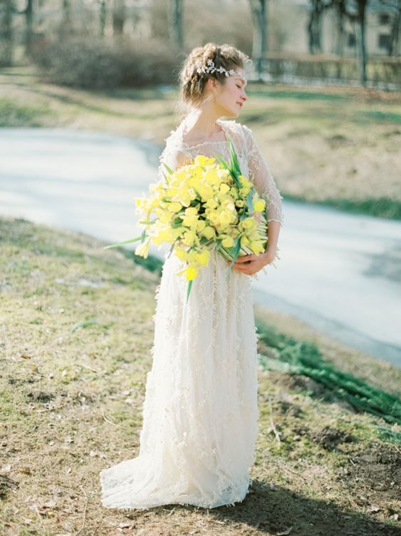 a bold yellow wedding bouquet with greenery is a bright accent to highlight your wedding look