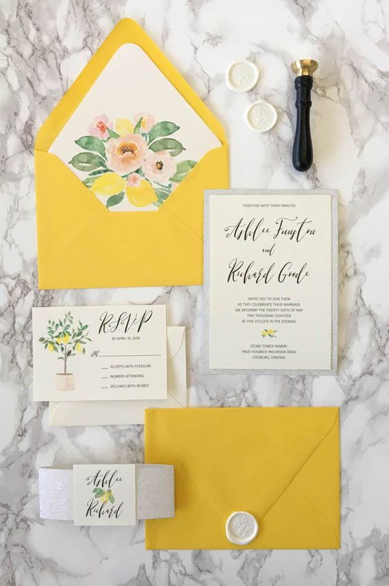 a bright and fun yellow wedding invitation suite with floral lining is a cool and bold idea
