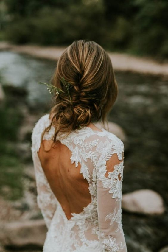 a chic lace applique wedding dress with a keyhole back, long sleeves and a high neckline is a lovely idea for a boho bride