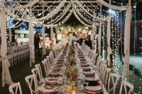 a delicate canopy formed with airy white fabric and lights make the space beautiful, chic and subtle