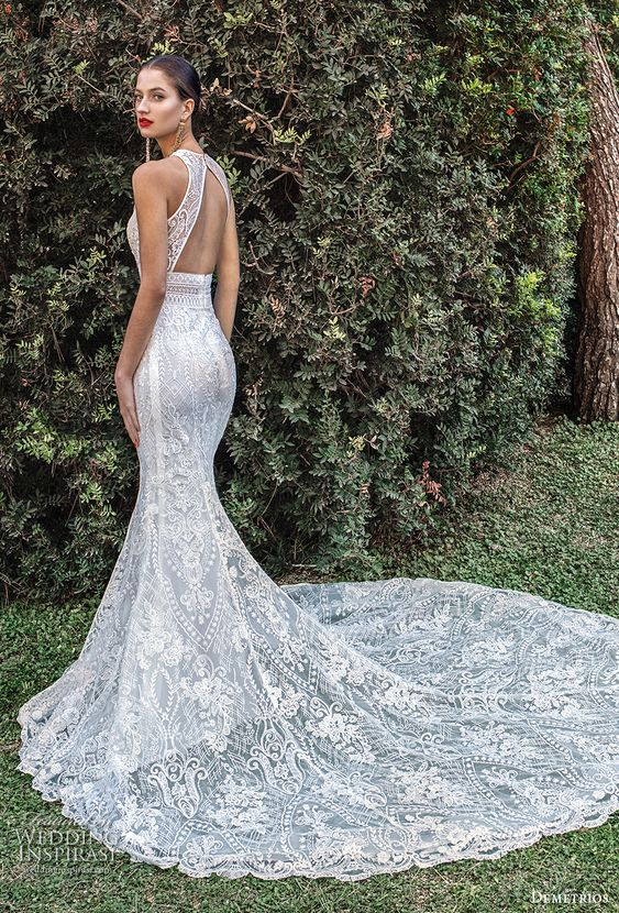 a dreamy keyhole back mermaid wedding dress fully made of lace, with a halter neckline and a train is a statement idea for a modern romantic bride