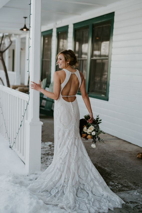 a fabulous boho lace mermaid wedding dress with a halter neckline, a keyhole back, a short train is a fantastic solution