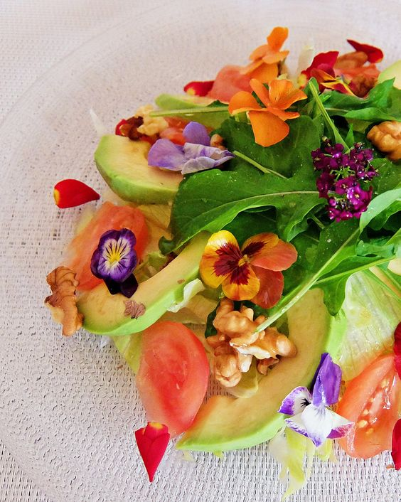 a fresh salad with avocado, nuts, arugula, pansies, nasturtium is very light and cool for a spring or summer wedding