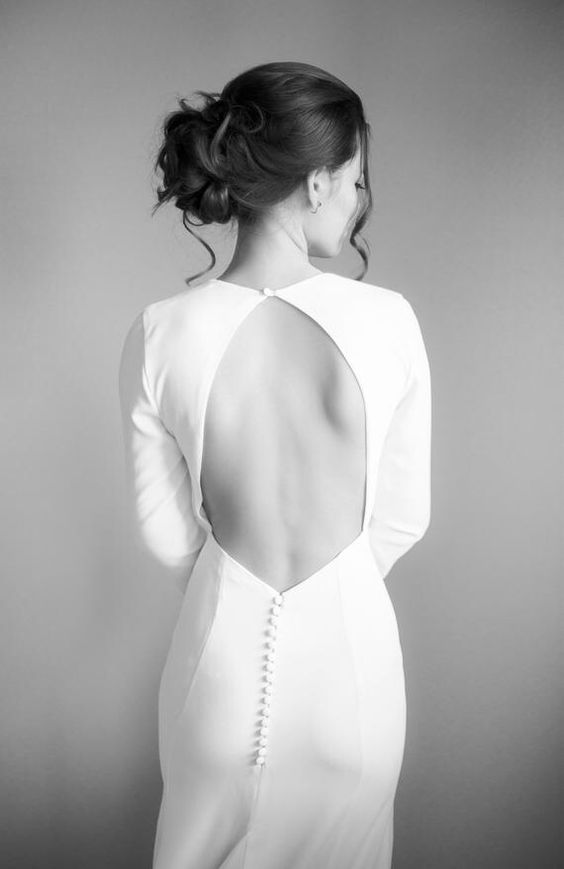 a gorgeous minimalist fitting wedding dress with a keyhole back, long sleeves, buttons and a high neckline is a lovely idea to rock