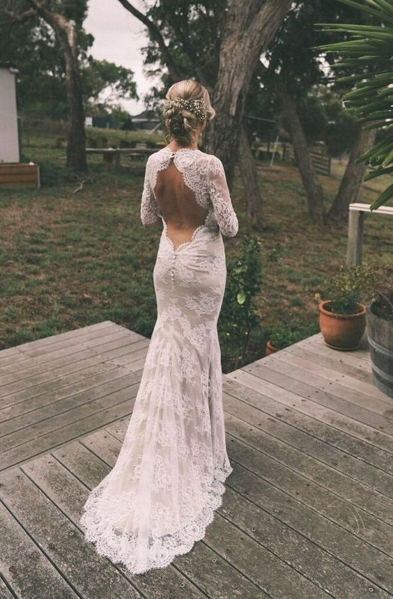 a lace mermaid wedding dress with long sleeves, a keyhole back, a short train and buttons on the back is a cool idea for a rustic bride