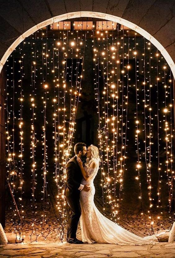 a light arch is a beautiful and statement-like idea to go for and a great backdrop for your ceremony