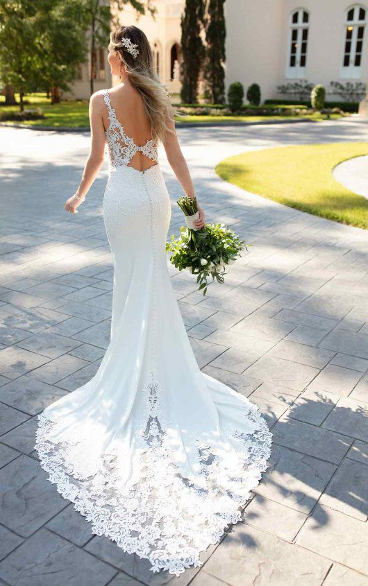 a lovely mermaid lace wedding dress with a cutout and a keyhole back, a short lace train and a V-neckline is very cool