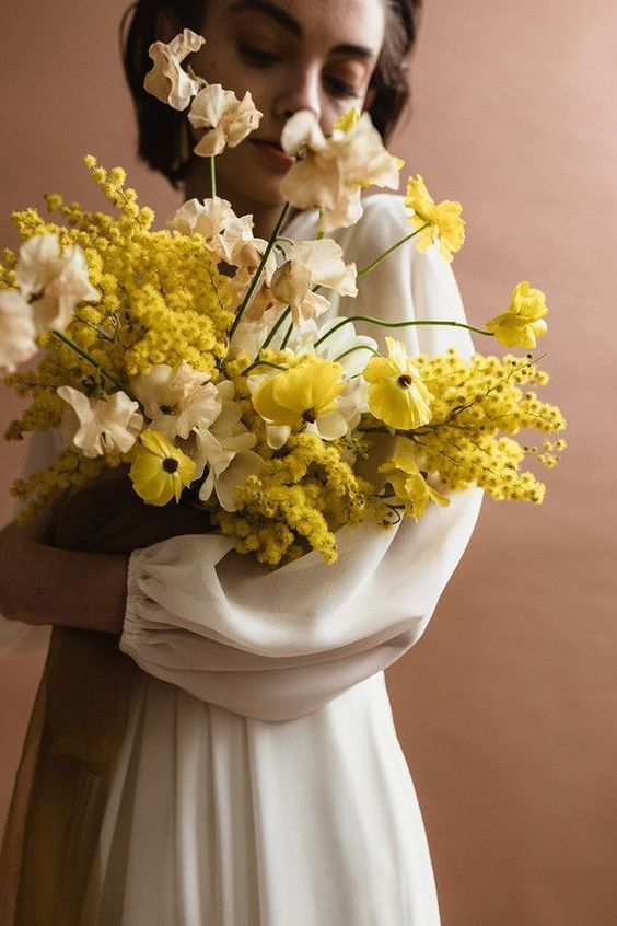 a lush and refined yellow and neutral wedding bouquet with much dimension is a bold solution