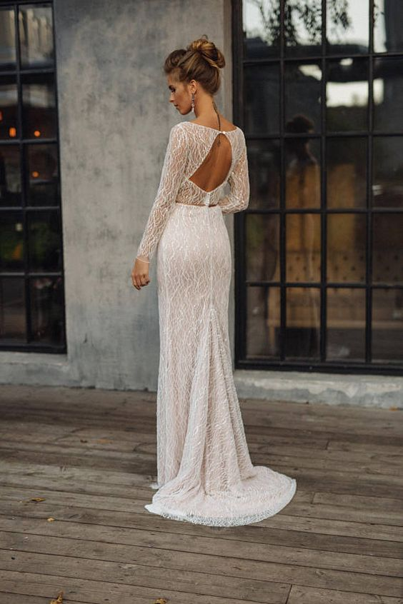 a mermaid lace wedding dress with a high neckline, long sleeves, a keyhole back and a short train with a touch of bling is amazing
