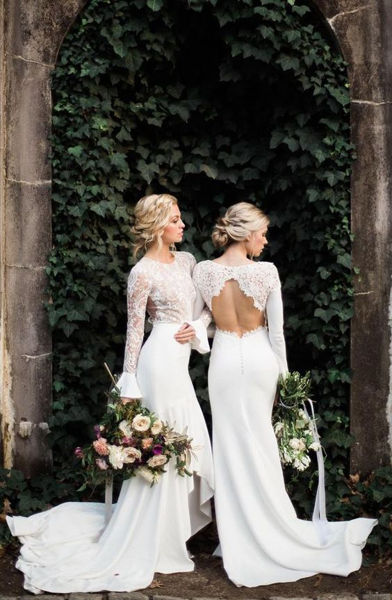 a modern chic fitting wedding dress with a lace bodice, a high neckline, long sleeves, a plain skirt with a short train
