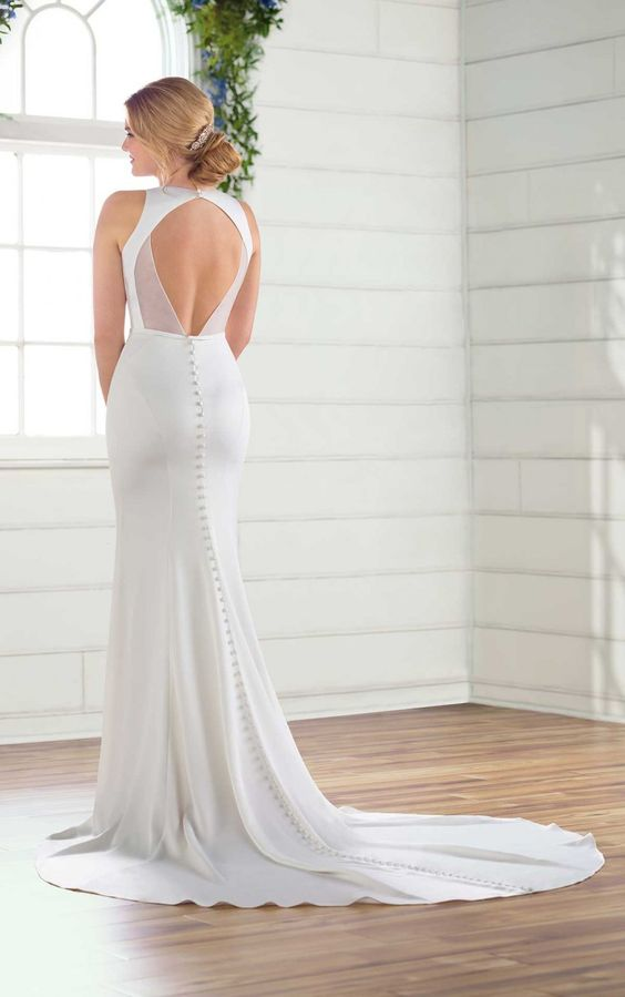 a sexy fitting mermaid wedding dress with keyhole back on buttons, a train, a halter neckline is a dreamy and beautiful idea