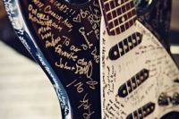 an electro guitar as a wedding guest book is a fun idea for a rock-n-roll wedding or a badass couple