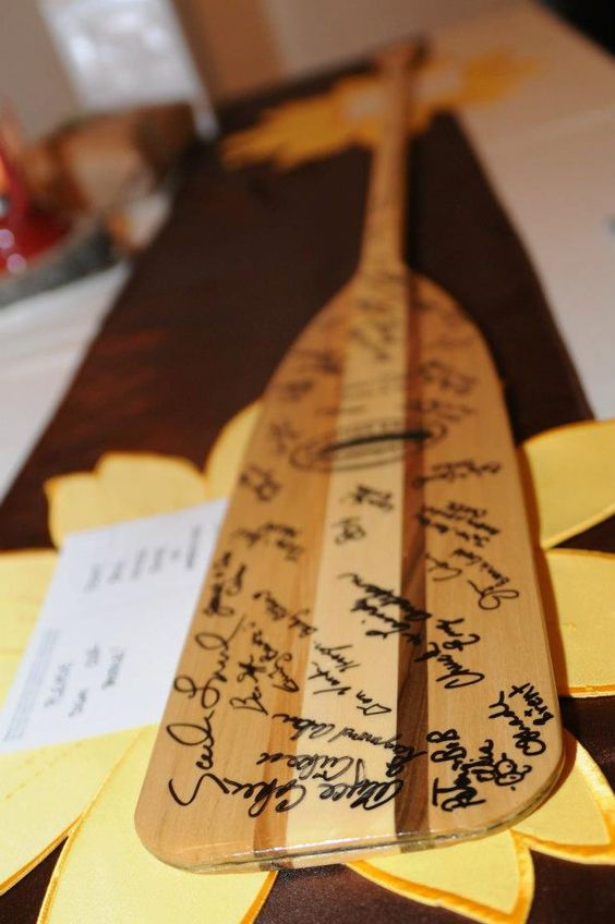 an oar is a creative wedding guest book especially for a river or lakeshore wedding