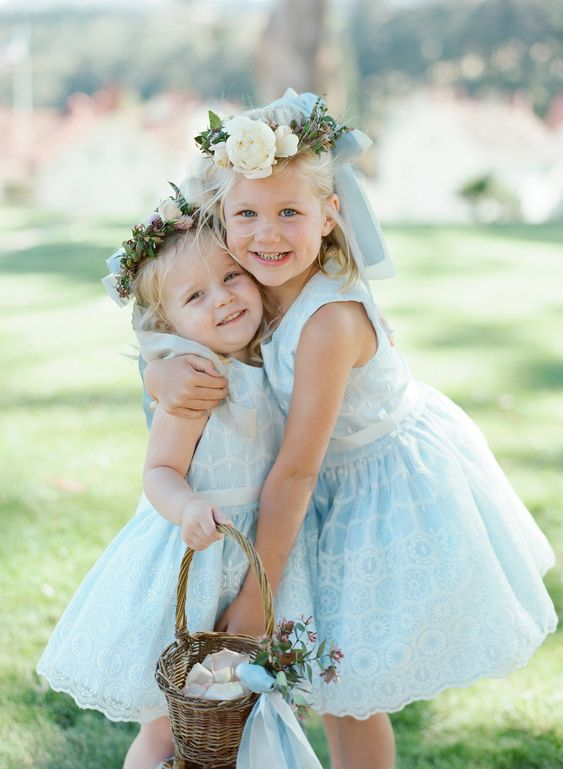 baby blue lace knee dresses with high necklines and no sleeves plus floral crowns are a pure perfection