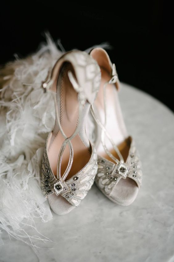bold art deco wedding shoes in off-white, with embellishments and thin straps look really wow