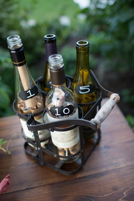 bottles with wish papers packed into a comfy wire basket for carrying milk bottles is a cool rustic or vineyard wedding idea