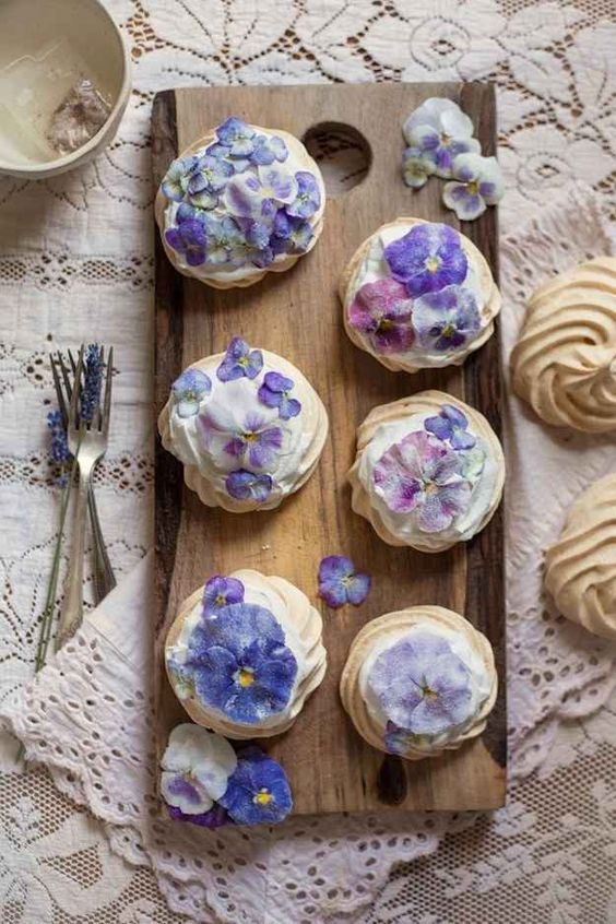 candied pansies and viola mini pavlova cakes are creative wedding desserts for spring or summer