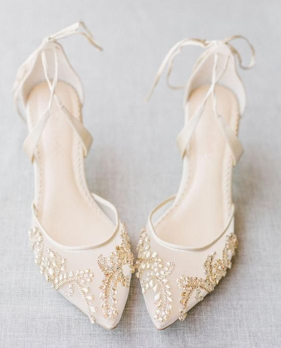 creamy sheer wedding shoes with white and gold embellishments attached in patterns are very sophisticated and intricate