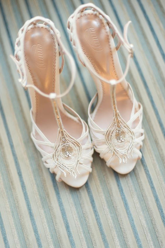 creamy strappy wedding shoes with embellishments and T straps are very refined and will add a touch of bling