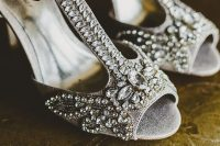 glam vintage wedding shoes in grey, with T-straps and heavy embellishments add a shiny touch to the look