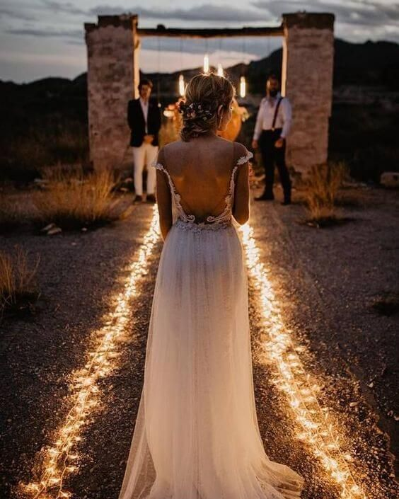 lights lining up the aisle are a gorgeous idea for an evening wedding ceremony and they won't break the bank