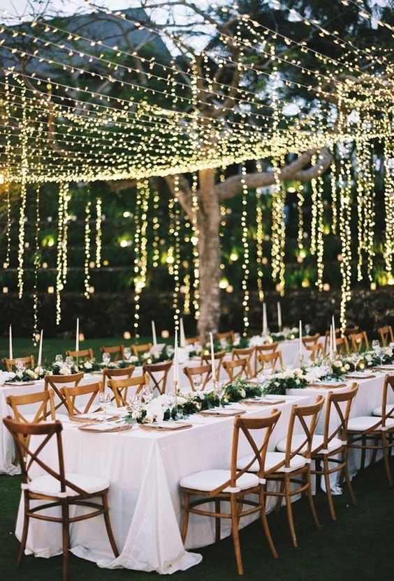 lights over the reception and hanging down in verticals make the reception look very festive and very romantic