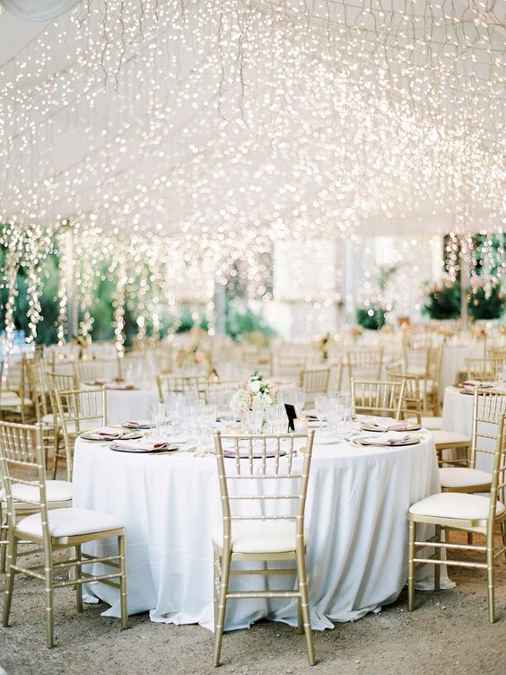 lots of lights hanging down to the reception bring more light and create a magical ambience in the space