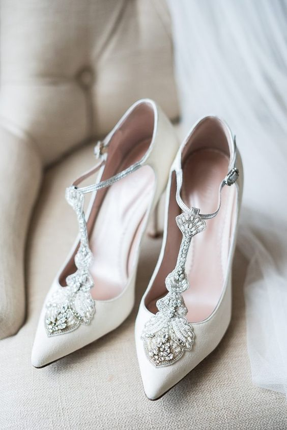 lovely white wedding shoes with embellished T straps will make yoru bridal look very refined and very chic