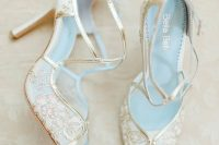 sheer gold lace peep toe wedding shoes with straps and blue bottoms are romantic and refined