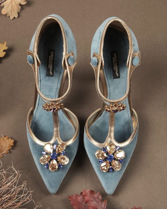 super refined vintage wedding shoes of blue velvet, gold touches and large embellishments for a touch of 'something blue'