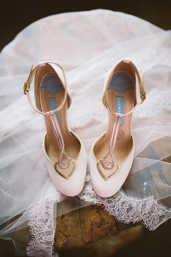 vintage-inspired blush and metallic wedding shoes with cutout hearts and T straps for a soft feel