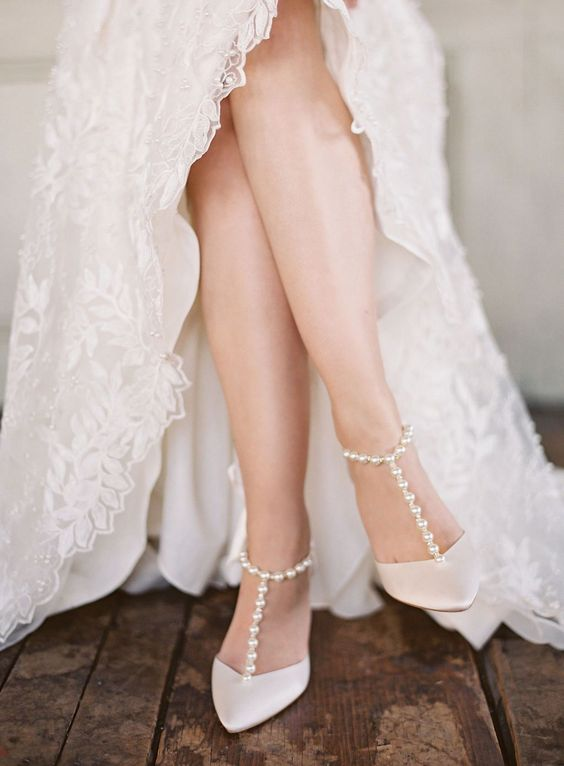 vintage inspired white wedding shoes with pearl straps bring a timeless and refined feel to the look