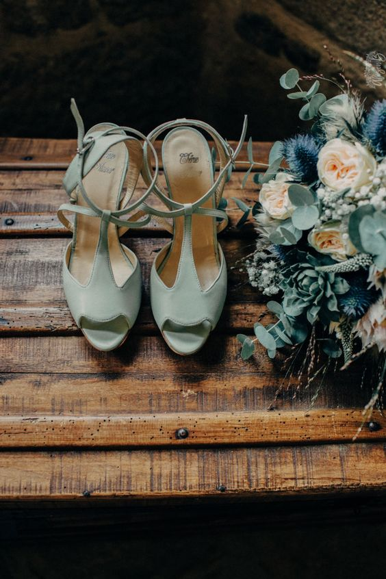 vintage mint-colored wedding shoes with T-straps are a soft touch of color and chic