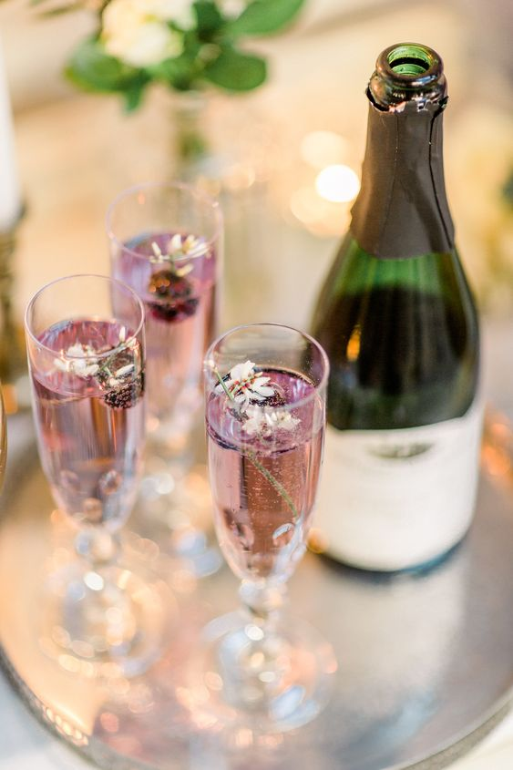 wedding drinks accented with edible blooms and fresh berries are delicious and romantic