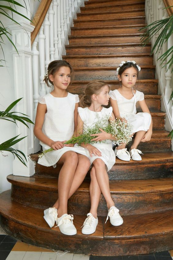 white mini dresses with cap sleeves and a scoop neckline, white sneakers are perfect for a casual wedding