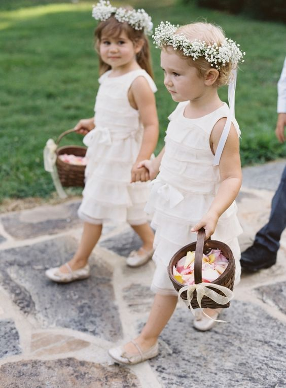 white sleeveless ruffle midi dresses and baby's breath crowns plus flat shoes for an elegant and traditional look