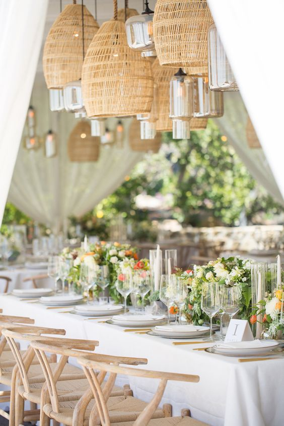 wicker lamps paired with smoked glass lamps over the reception table make the space a bit rustic yet very chic