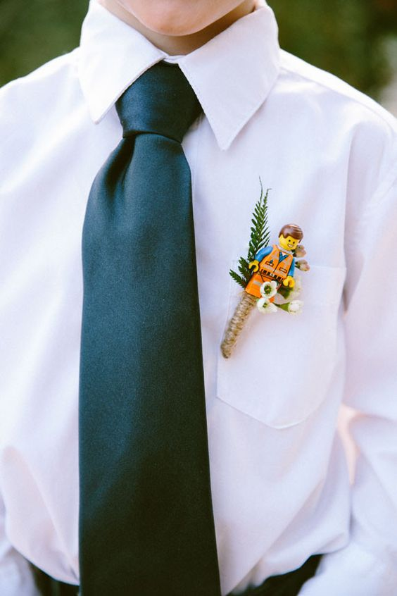 a Lego wedding boutonniere with greenery and blooms is ideal for a true Lego fan and will add a touch of whimsy to the look