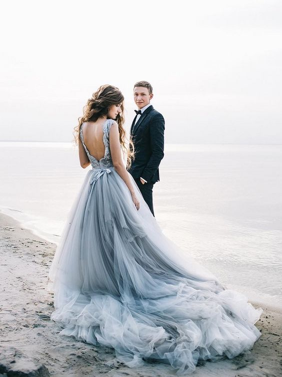 a beautiful grey wedding ballgown with a layered tull skirt, a lace bodice with a cutout back and a sash for a romantic look