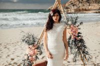 a boho lace mermaid wedding dress with cap sleeves and a train plus bright florals