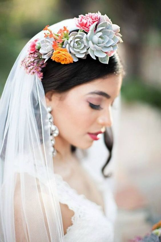 a bold floral and succulent crown and a veil is a bold and chic accessory for a beautiful bridal look