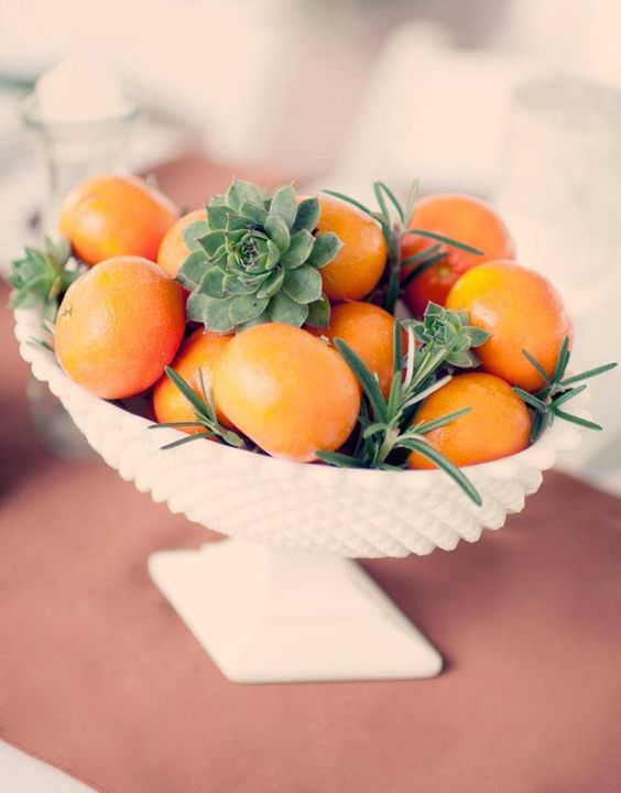 a bowl with citrus, succulents and greenery is great for a tropical or southern wedding