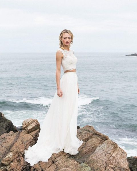 a bridal separate with a lace sleeveless crop top and a flowy A-line skirt for a fashion-forward beach bride