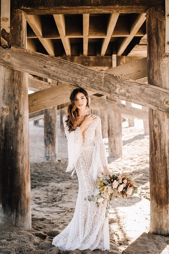 a chic boho lace mermaid wedding dress with a plunging neckline, bell sleeves is a stunning idea