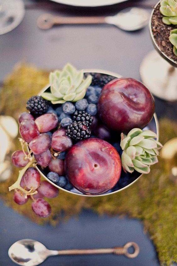 a chic centerpiece with grapes, plums, blackberries, blueberries and succulents in a bowl