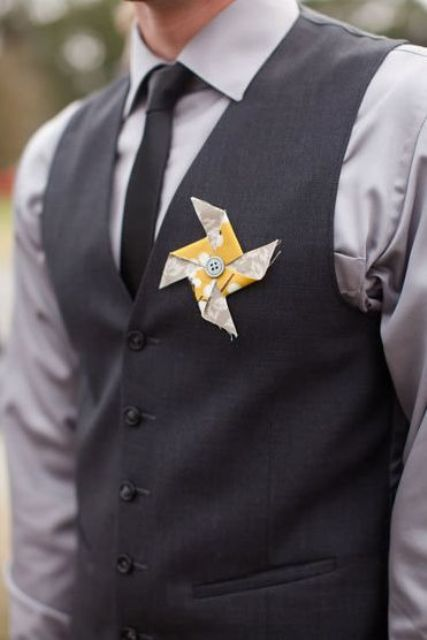 a colorful paper fan wedding boutonniere with a button is a cool and bold idea for rocking in summer