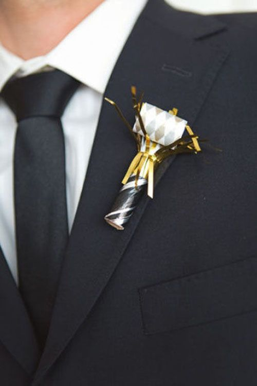 a cool black, white and gold Cracker wedding boutonniere is ideal for a NYE wedding