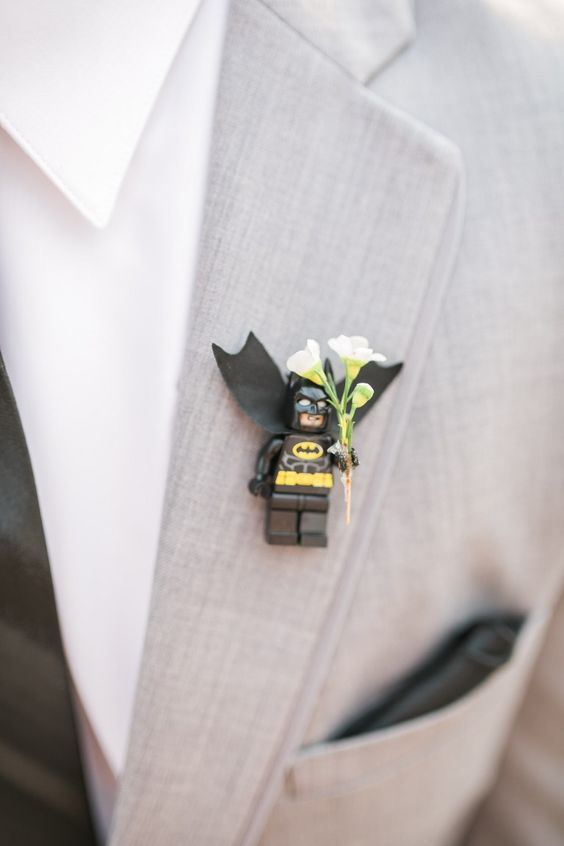 a creative Lego Batman wedding boutonniere with blooms for a groom who feels a superhero