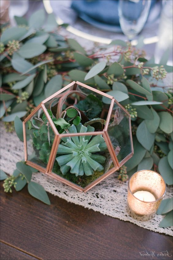 a cute copper terrarium with moss and airplants plus succulents and lush eucalyptus for a table runner